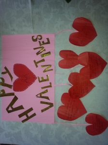 The happy valentines banner my daughters made for me. Each hanging hearts contains a special love message